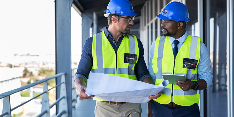 A Security 101 sales engineer performs a site walk and review with a client